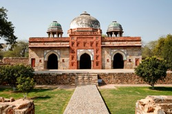 The mosque, Isa khan tomb has single prayer chamber which is divided into three bays. Each bay houses a four-arched gateway to the mosque, whose borders are decorated with color tiles.