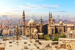 The Mosque-Madrassa of Sultan Hassan and the city in the mist, Cairo, Egypt