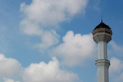 The mosque tower of bandung with the clouds background