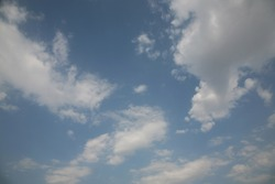 The most beautiful clouds as a picture fly in the blue sky against the background of the best skies they have a very abstract view