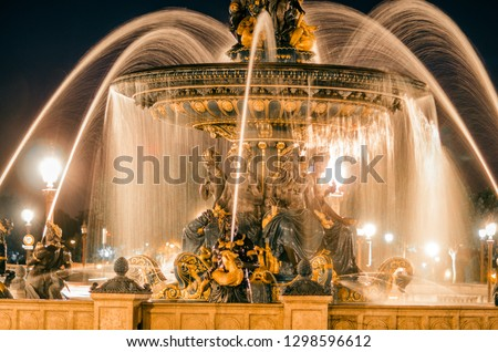 The most famous place in paris at the bottom of the champs elysées call place de la concorde with fountains at the night with light ic the center of paris in france , tourism inspiration  #1298596612