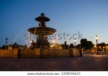 The most famous place in paris at the bottom of the champs elysées call place de la concorde with fountains at the night with light ic the center of paris in france , tourism inspiration  #1298596615