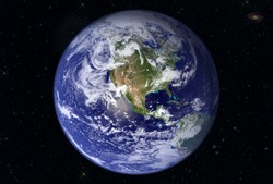 The mother Earth, against the background of the star sky, with the far galaxy.  Elements of this image were furnished by NASA
