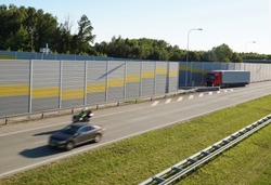 The motorway is protected against noise emission by noise-absorbing barrier (also called a soundwall, noise barrier, sound barrier) is an exterior structure designed to protection of people against no