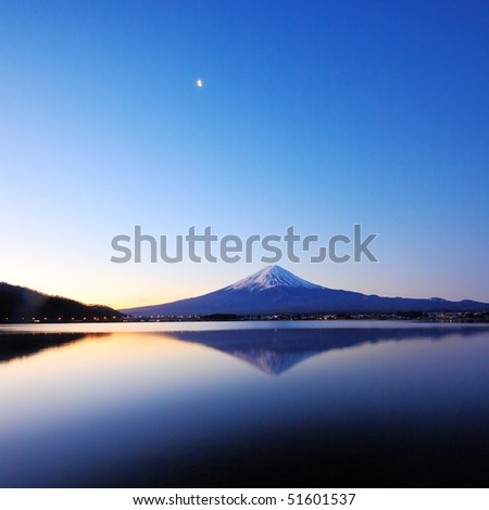the mountain Fuji at dawn with peaceful lake reflection