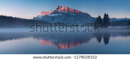 Photo of  The mountain views when you are in Two Jack Lake campground of Banff National Park in Alberta, Canada. Beautiful morning durin autumn time. Nature background concept.