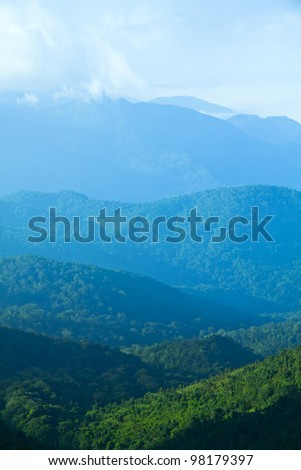 The mountains are green, white haze in the north of Thailand. - stock photo