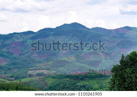 The mountains are lush green. #1110261905