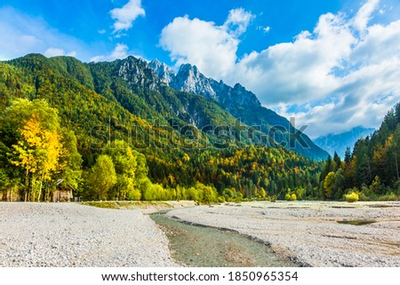 The mountains are overgrown with dense mixed forest. The famous Triglav Park. Travel to Eastern Julian Alps, fabulous Slovenia. The shores of Lake Jasne. Great Pysnitsa Stream.  Zdjęcia stock ©