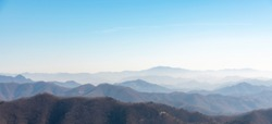The mountains of Korea have become impressive landscapes due to the blue sky and fog.