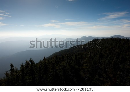 The mountaintops and ridges of the White Mountain National Forest as seen from Mt. Carrigain in late summer.
