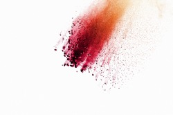 The movement of abstract dust explosion frozen red and orange on white background. Stop the movement of powdered orange-red on white background. Explosive powder red and orange on white background.