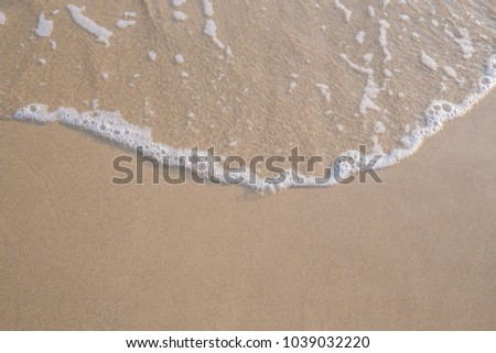 The movement of the waves on the sand is smooth and fine for  background, #1039032220