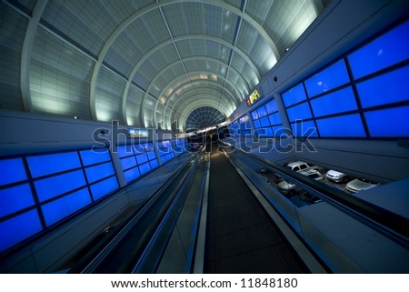 The moving walkway leading to the Las Vegas Sidewalk from a strip  casino.