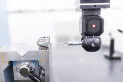 The multi-axis, coordinate measuring machine, CMM probe measure dimension of the conecting rod automotive parts.