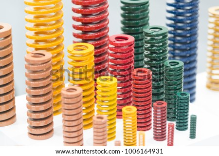 The multi color of coil spring on the floor .The  coil spring for industrial purpose #1006164931
