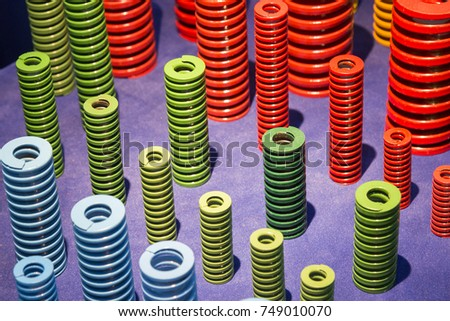 The multi color of coil spring on the floor .The  coil spring for industrial purpose  #749010070