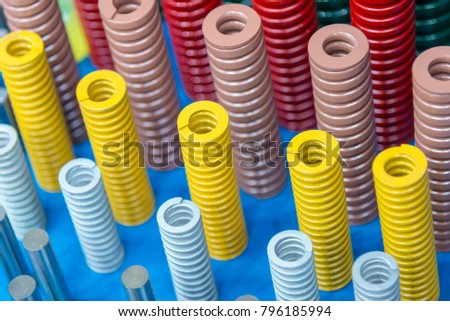 The multi color of coil spring on the floor .The  coil spring for industrial purpose #796185994