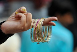 The multi-color verity of Hard end Bangle in hand New Delhi Indian.