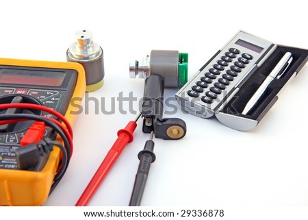 The multimeter, sensors and calculator isolated on white background