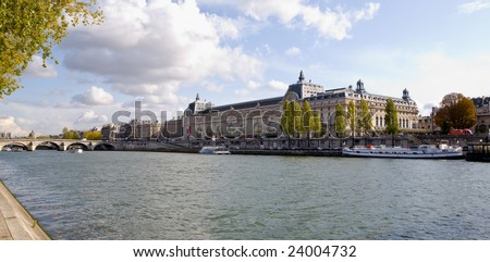 The Musee d'Orsay Museum along the banks of the seine River in Paris, France on an autumn day