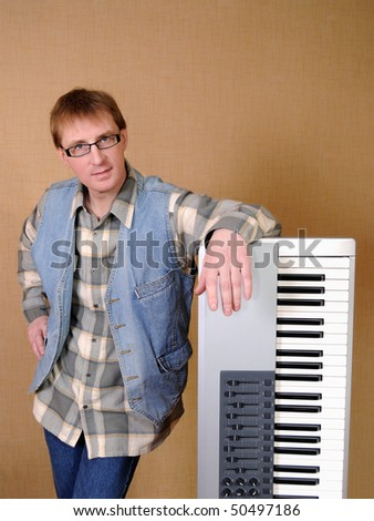 The musician in glasses and a synthesizer