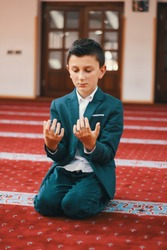 The Muslim prays in the mosque, the little boy prays to God