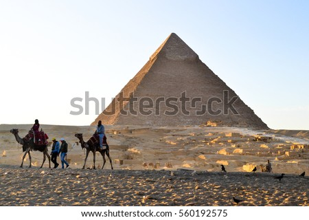 The mysterious old  legacy of ancient Egypt - the Greatest wonder of the world, the Egypt pyramids and the stone Sphinx on the Giza platou in endless sands of the Sahara desert