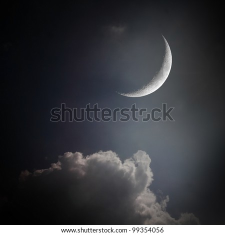 the mystery half crescent moon at the night sky with cloud - stock photo