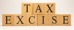 The name Excise tax was created from wooden letter cubes. Economics and finance. close up.
