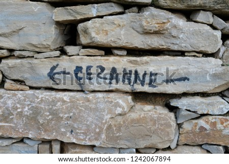 The name of an artist Paul Cezanne written on a stone wall on the Cezanne trail in Aix en Provence, France.