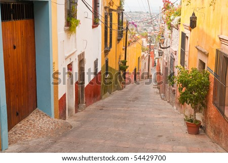 The narrow, hillside  streets of colorful San Miguel Allende Mexico - a World Heritage Site