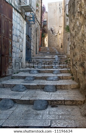 The narrow street in the Arab quarter of the Old City of Jerusalem.