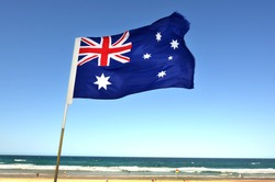 The National flag of Australia fly over Surfers Paradise main beach in Gold Coast Queensland, Australia. No people. Copy space