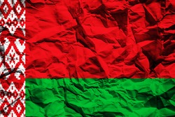 The national flag of Belarus on crumpled paper. Flag printed on a sheet. Flag image for design on flyers, advertising.