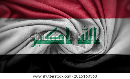 The national flag of Iraq. Iraq flag with fabric texture. Close up waving flag of Iraq.