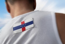 The national flag of Netherlands Antilles on the athlete's back