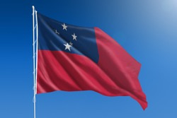 The National flag of Samoa blowing in the wind in front of a clear blue sky