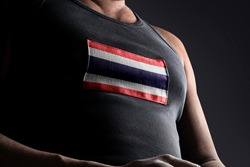The national flag of Thailand on the athlete's chest