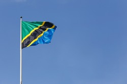 The national fllag of Tanzania on blue sky.