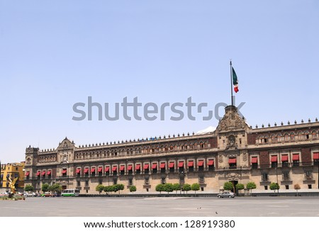 The National Palace (Palacio Nacional in Spanish) is the seat of the federal executive in Mexico City. It is located on the main square, Plaza de la Constituci�³n (El Z�³calo), in the historic downtown. - stock photo