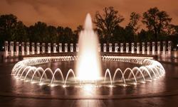 The National World War II Memorial Fountains at night in Washington, DC.