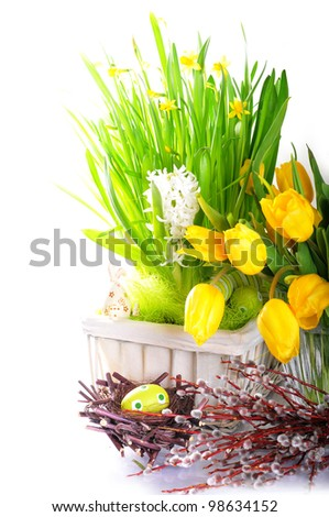 The nest with  egg, willow, flowers and rabbit
