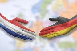 The Netherlands and Germany - Flag handshake symbolizing partnership and cooperation
