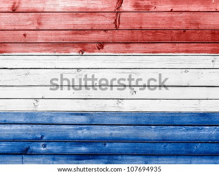 The Netherlands flag painted on wooden fence