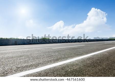 The new asphalt road under the blue sky