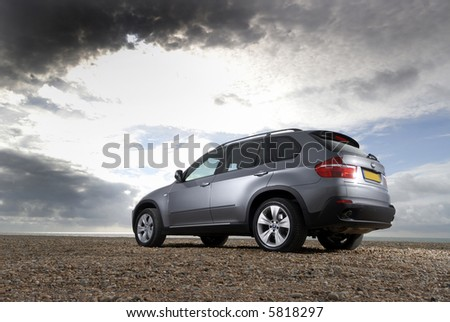 The new BMW X5 lit under a moody sky