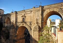 The New Bridge (Puente Nuevo) and the Ronda Gorge (Tajo de Ronda) on the Guadalevin River. The town of Ronda is a famous tourist landmark in Andalusia, Spain