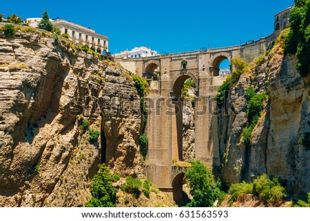 Shutterstock The New Bridge (Puente Nuevo) is the 120-metre (390 ft)-deep chasm that carries the Guadalevin River and divides city of Ronda, Province Of Malaga, Spain