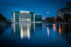 The new building of Bucharest National Library on Splaiul Unirii at night with full moon